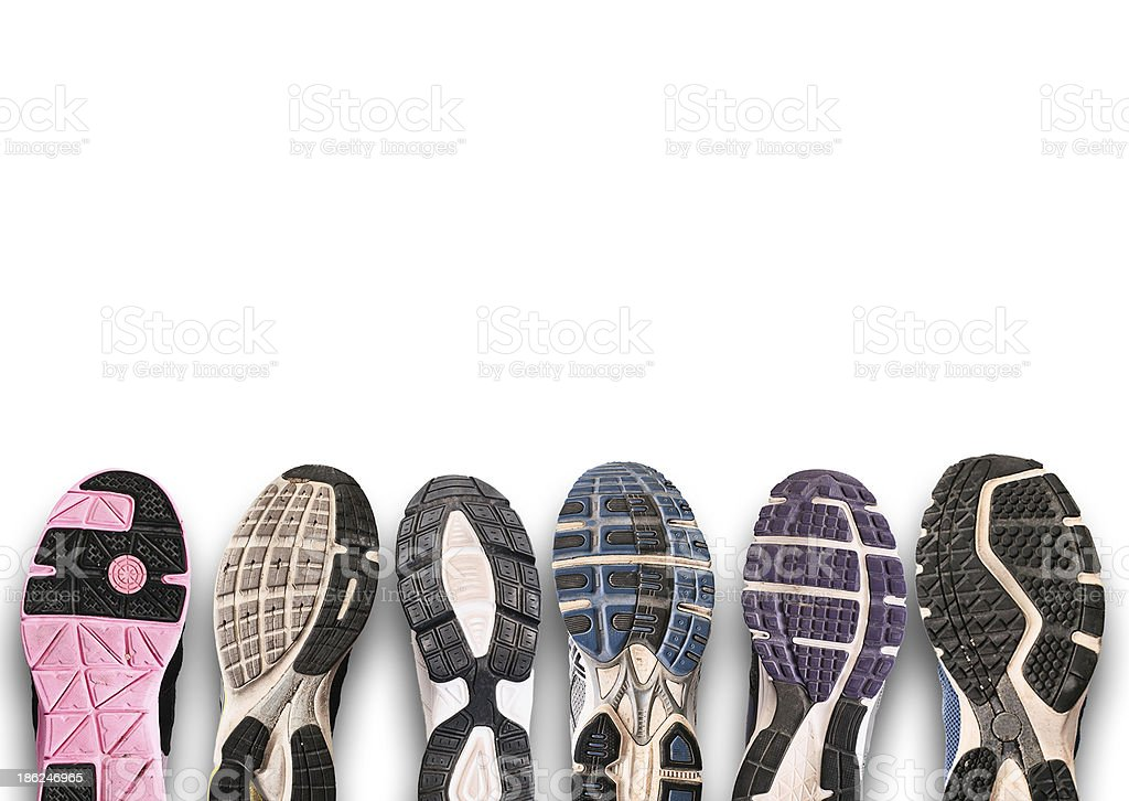 Photograph of different shoe soles on a gray background stock photo