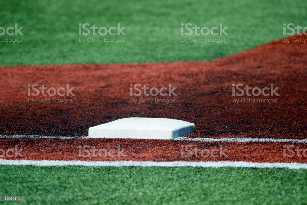 Photograph of first base before a baseball game. stock photo