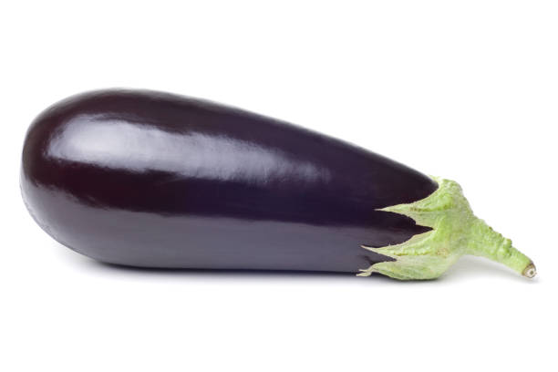 Photograph of fresh single eggplant on a white background stock photo