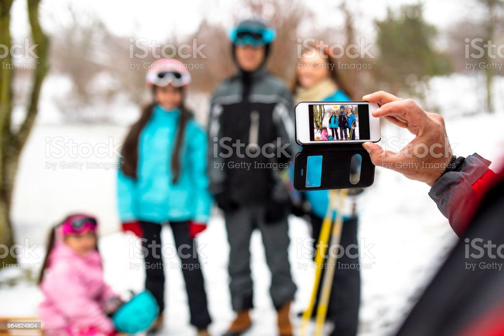 Photograph of his Family in the Snow royalty-free stock photo