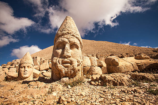 Photograph of large statues in Nemrut Ruins on Nemrut Mountain. anatolia stock pictures, royalty-free photos & images