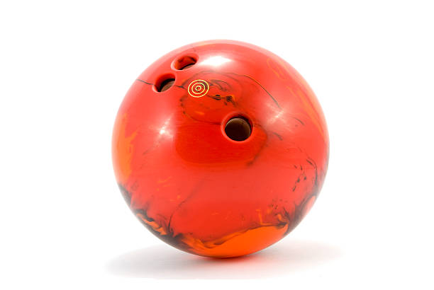 Photograph of red marbled bowling ball stock photo