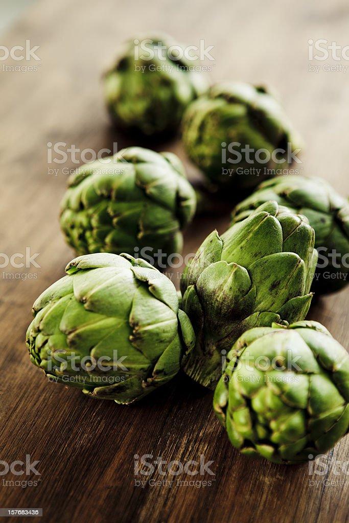 A photograph of seven whole fresh green artichokes royalty-free stock photo