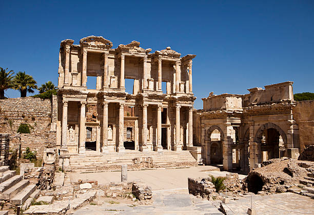 Photograph of the Library of Celsus at Ephesus The front facade and courtyard of the library building at Ephesus is an imposing ancient Greek and Roman structure. Built from old stone and reconstructed by archaeologists, it is a popular tourist stop near the city of Izmir in Turkey. celsus library stock pictures, royalty-free photos & images