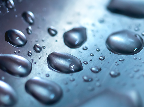 Photograph of water droplets inside a kitchen sink.