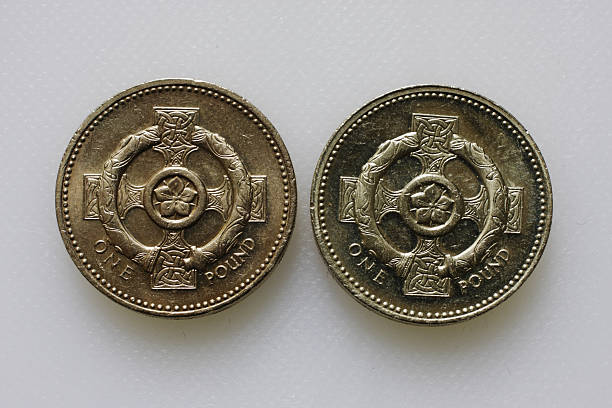 british pound coins 2001 and 1996 celtic reverse sides comparison - whiteway money stock photos and pictures