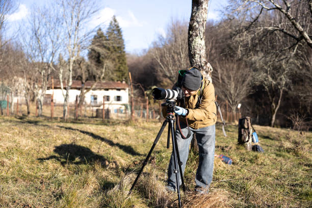 Photographer adjusting camera on tripod in rural scene stock photo picture id1219092043?b=1&k=6&m=1219092043&s=612x612&w=0&h=t9qgxwsz0w5kklnsr1ynjhkvn7vcniwgh3fobjavx4m=
