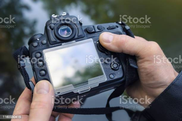 Photographer adjusts the camera picture id1160030415?b=1&k=6&m=1160030415&s=612x612&h= g1hbuoqp6mgpad8rzq4irrn7os1foayhliguge7trc=