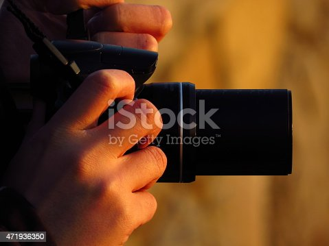 photographer and his zoom camera at sunset