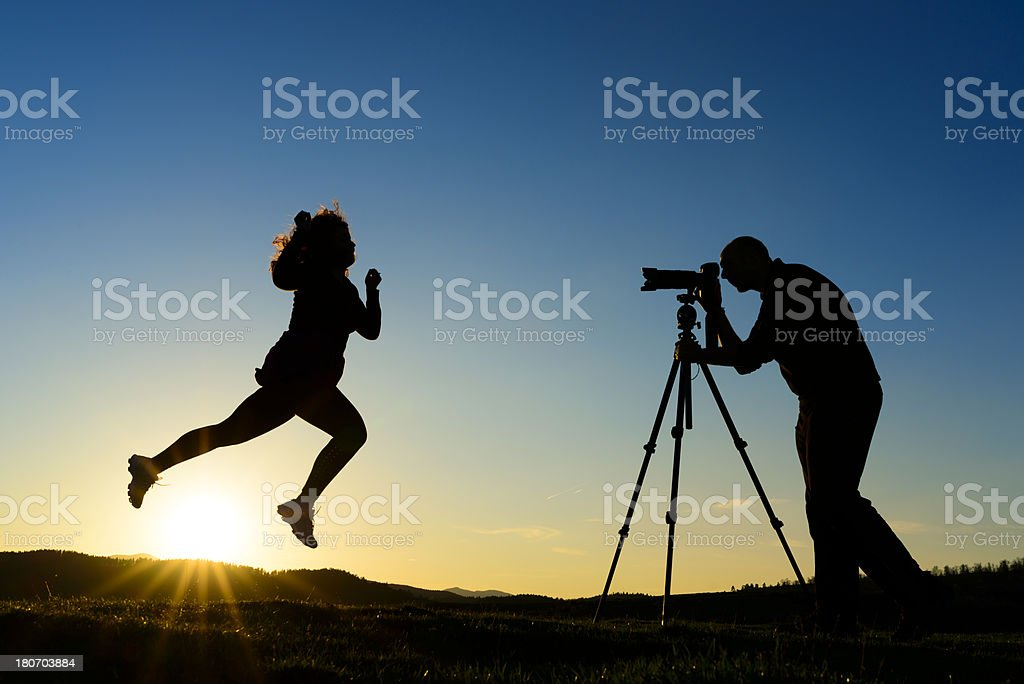 photographer and model silhouettes royalty-free stock photo