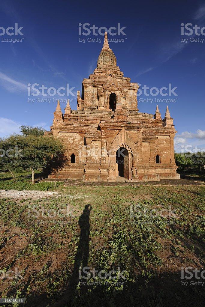 Photographer and pagoda in Bagan, Myanmar royalty-free stock photo