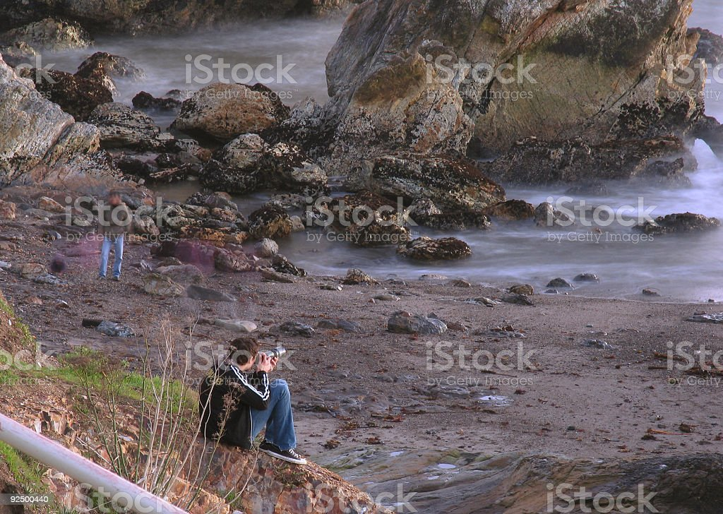 Photographer and Passerby on the Beach royalty-free stock photo