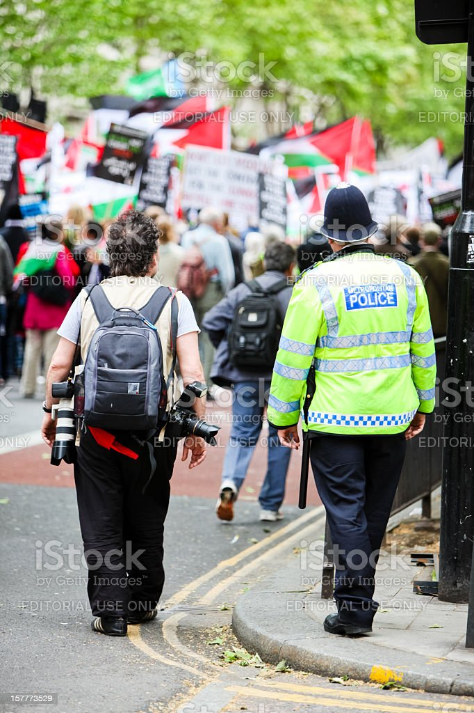 Photographer and Policeman royalty-free stock photo
