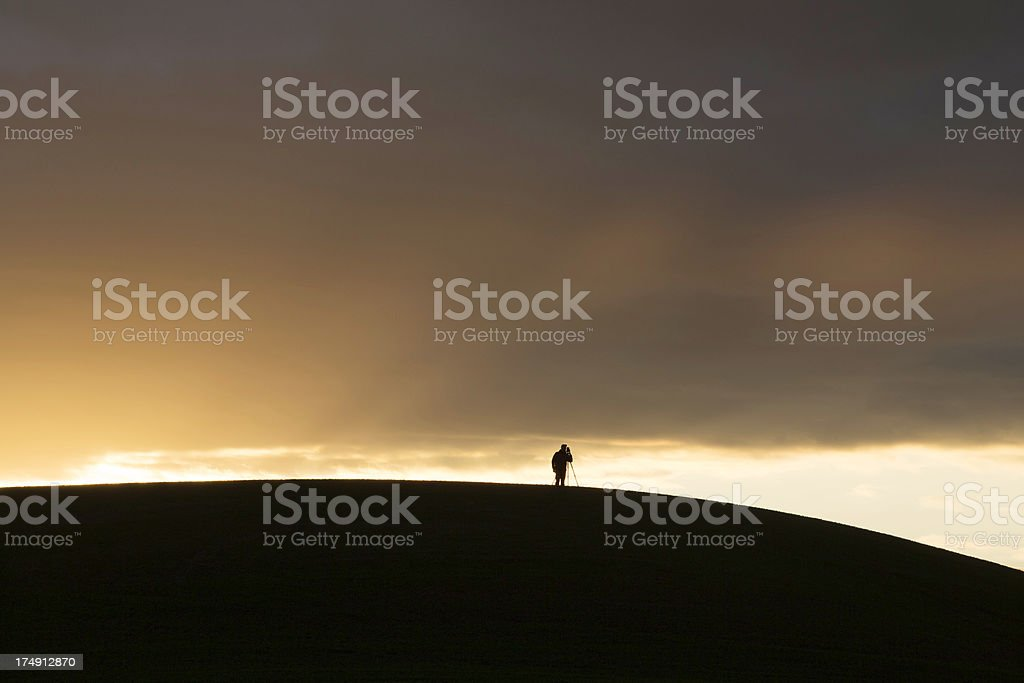 Photographer and Sunset royalty-free stock photo