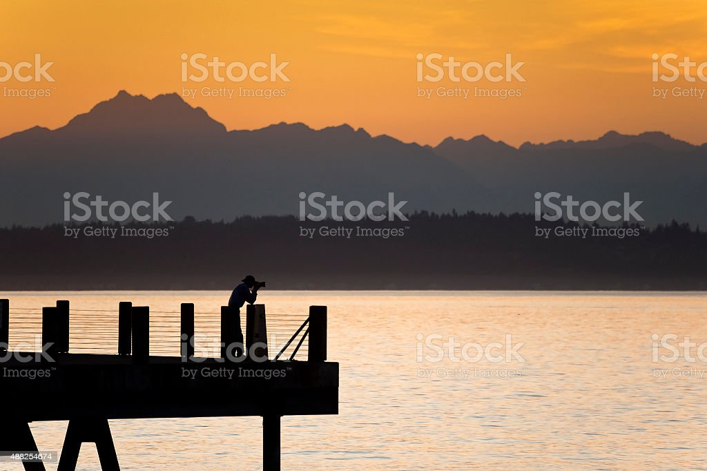 Photographer and the Olympic Mountains stock photo