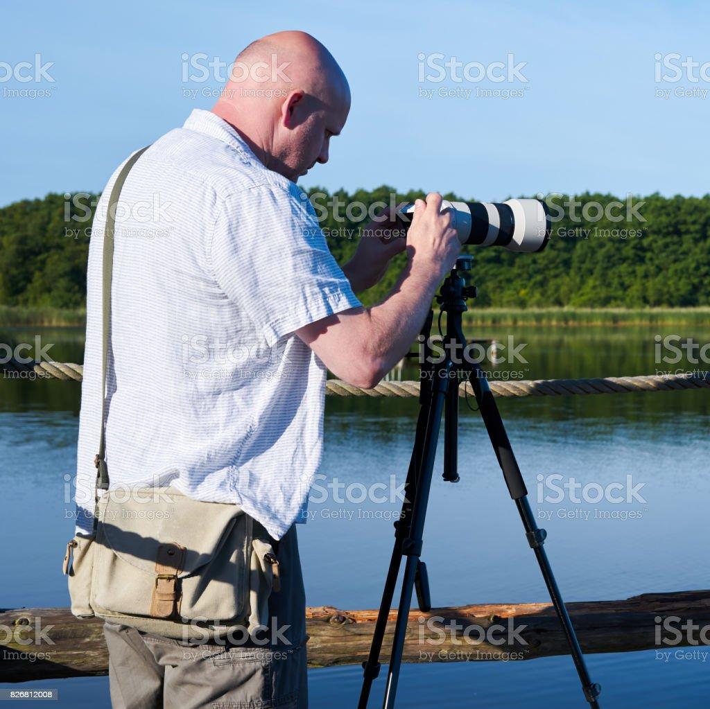 Photographer at a lake stock photo