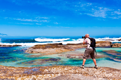 Photographer At Coastline Stock Photo - Download Image Now