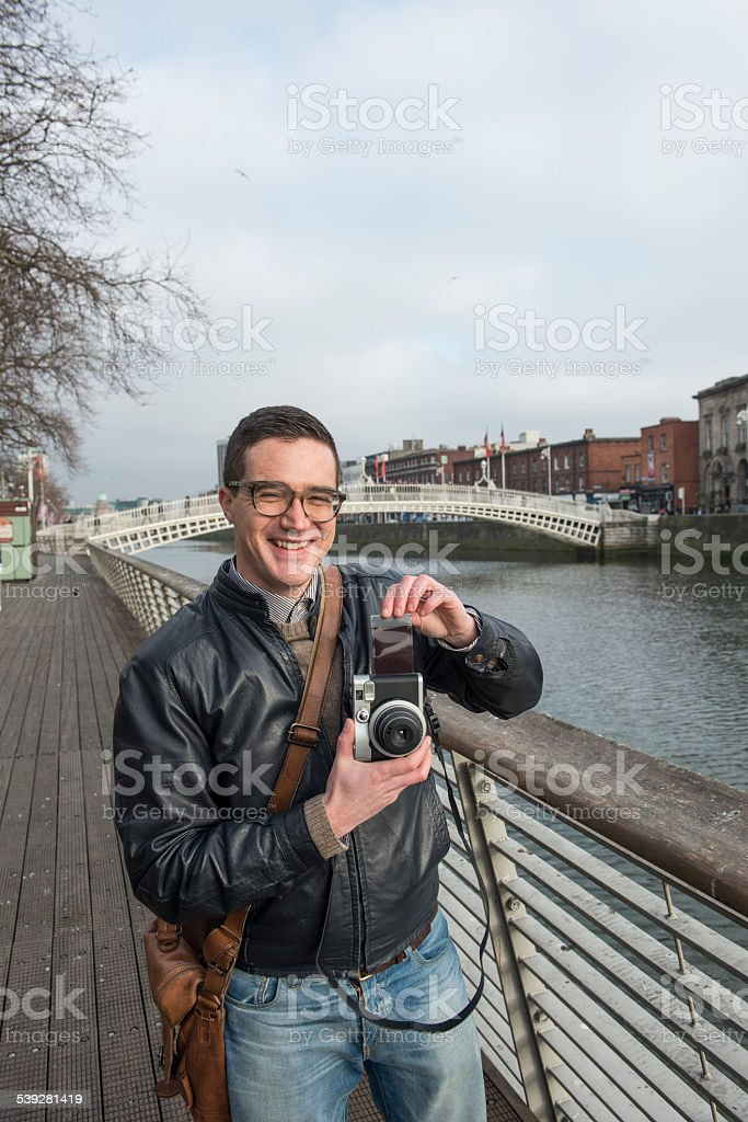 Photographer at Ha'Penny Bridge, Dublin, Ireland. royalty-free stock photo