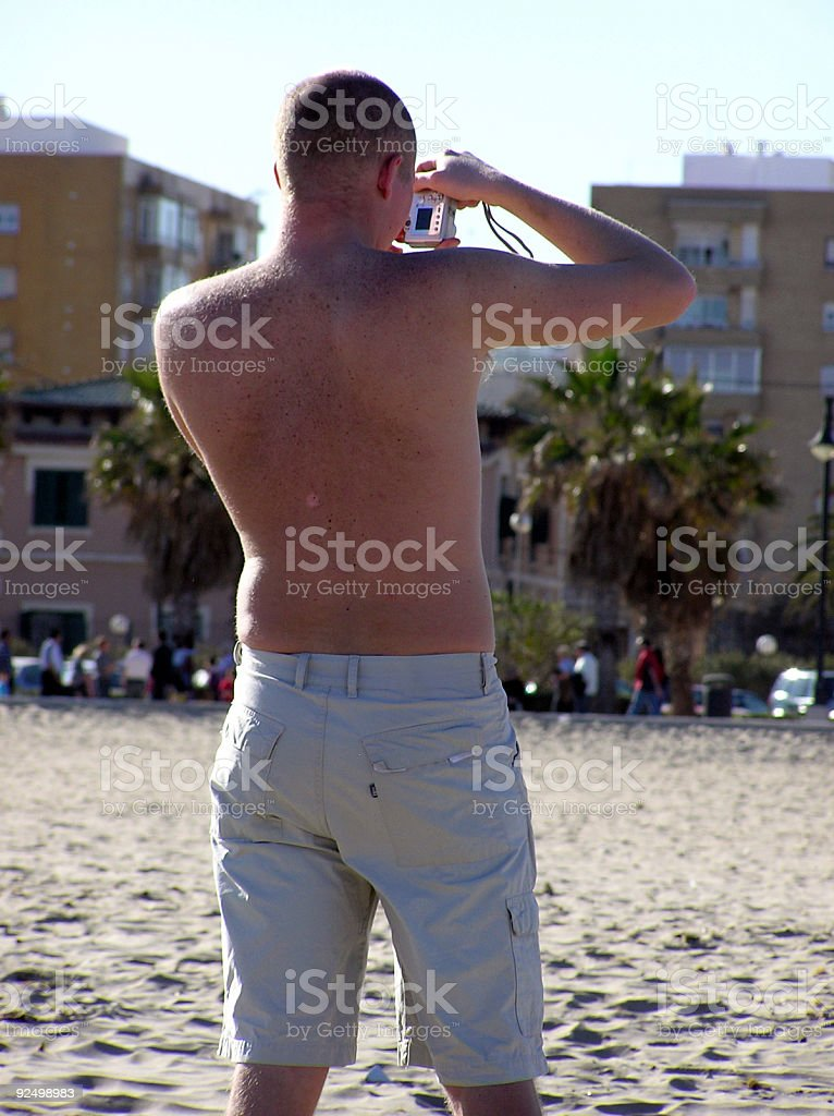 Photographer at the beach royalty-free stock photo