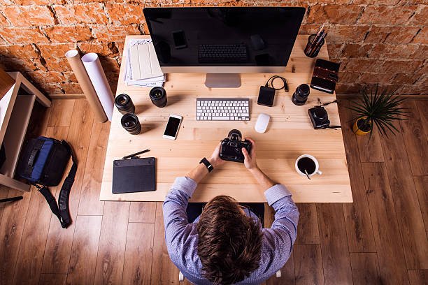 photographer at the desk, office gadgets and object lens - external hard disk drive stock photos and pictures