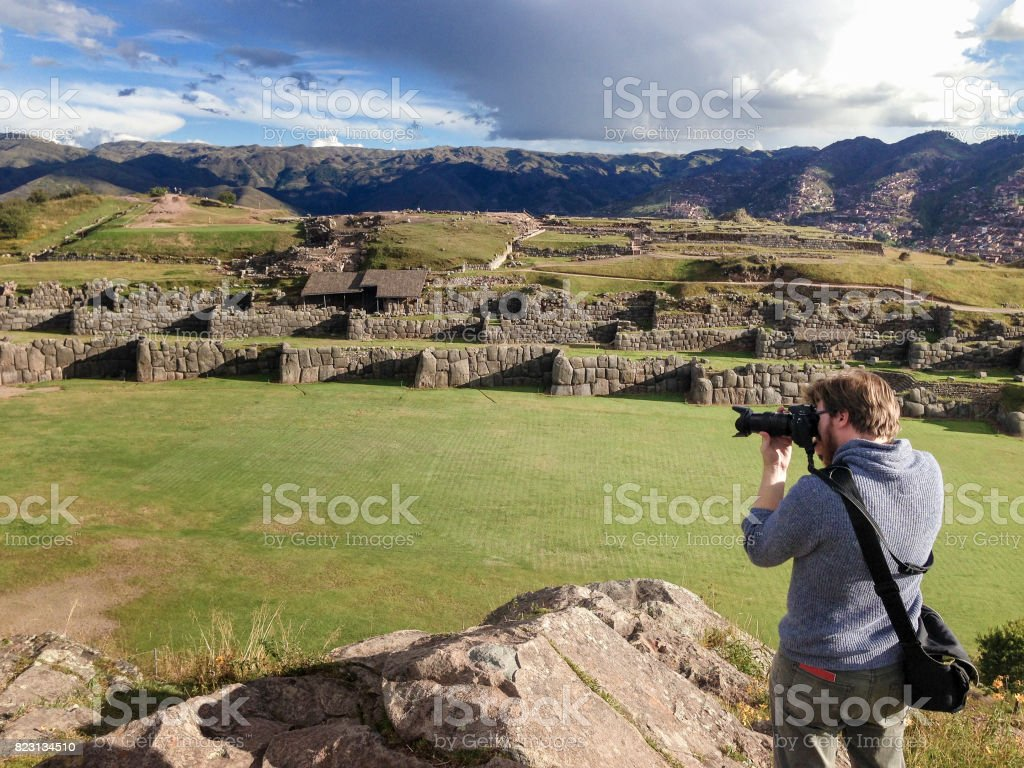 Photographer At The Inca Ruins Of Sacsayhuaman In Cusco, Peru stock photo