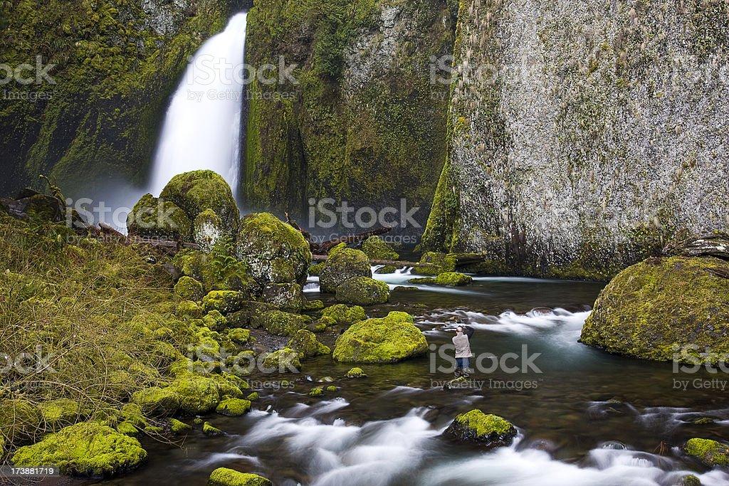 Photographer at Wahclella Falls royalty-free stock photo