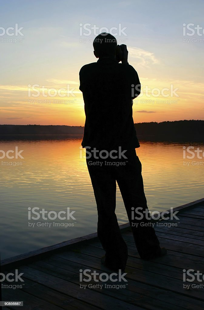 photographer capturing sunset #2 stock photo