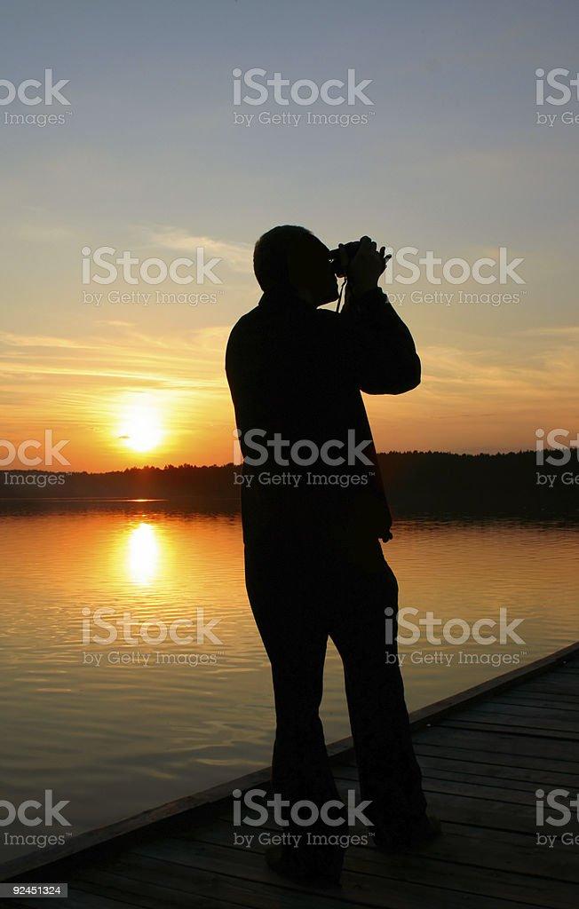photographer capturing sunset royalty-free stock photo