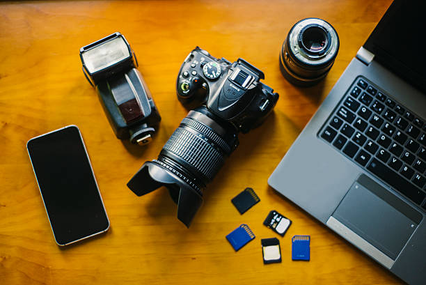 photographer desk - camera photographic equipment stock photos and pictures