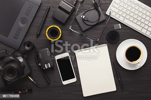 istock Photographer equipment and blank notepad 961759458