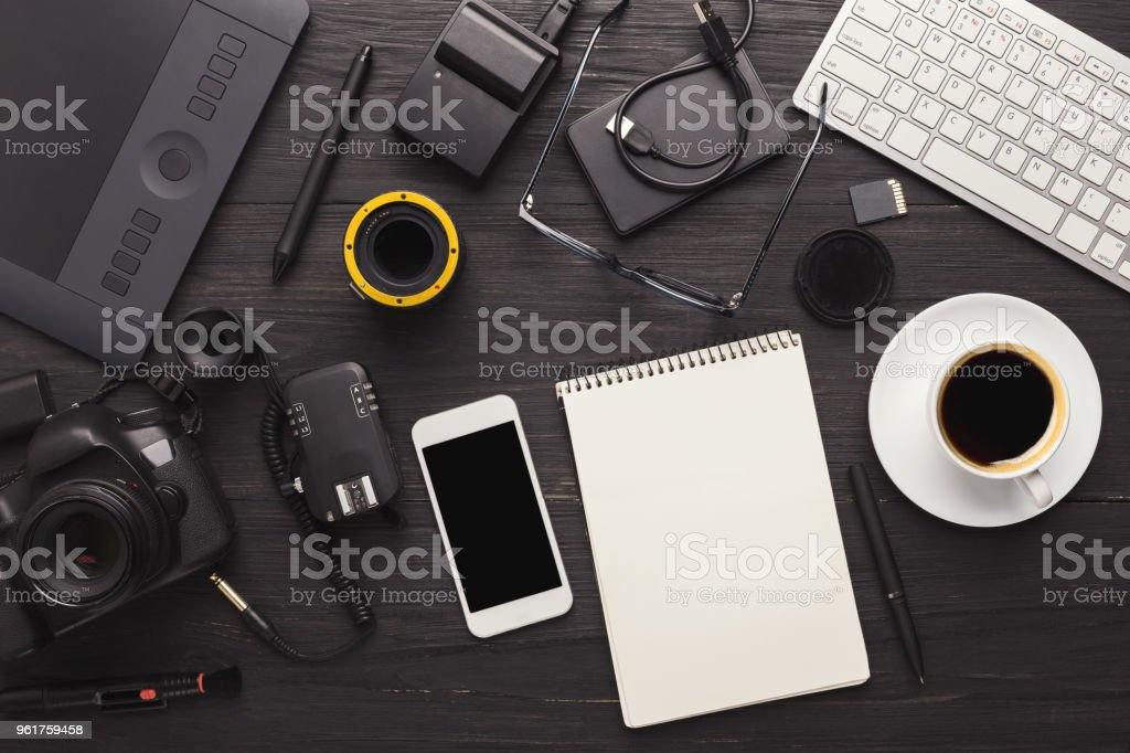 Photographer equipment and blank notepad stock photo