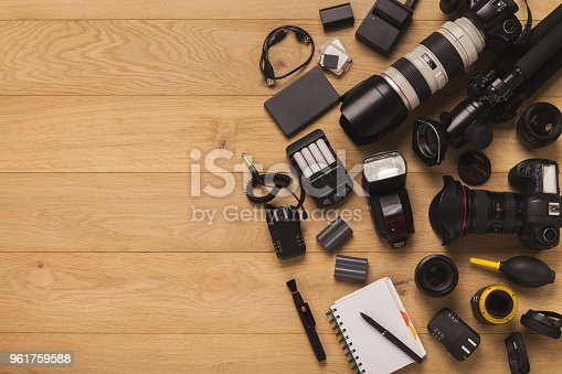 istock Photographer equipment and blank notepad 961759588