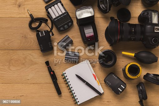 istock Photographer equipment and blank notepad 962199856