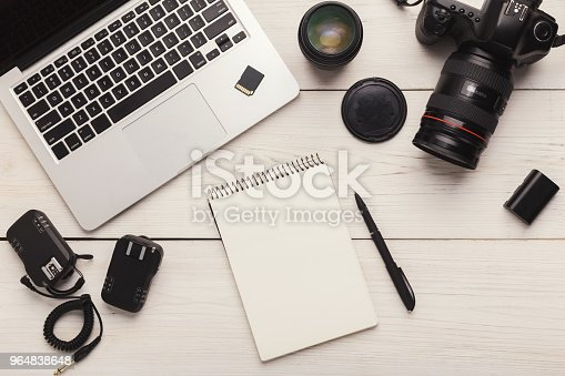 istock Photographer equipment and blank notepad 964838648