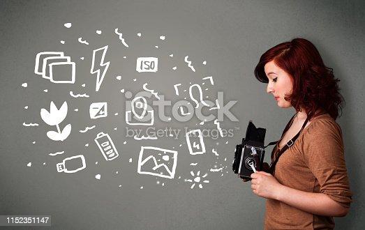 istock Photographer girl capturing white photography icons and symbols 1152351147