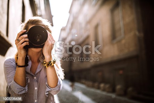 Photographer Girl Taking Pictures Using Digital Camera In Milan, Italy