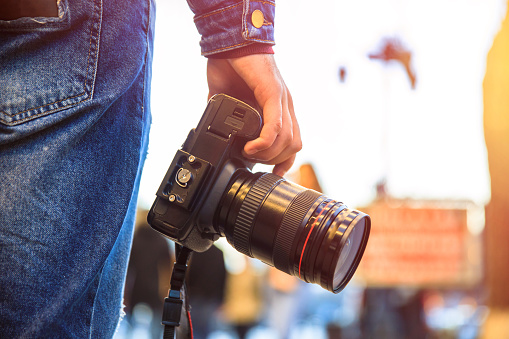 photographer hand camera in the street background