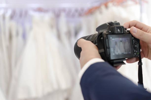 Photographer hold dsrl camera in his hands and taking photo picture id870548948?b=1&k=6&m=870548948&s=612x612&w=0&h= fmqxsql 6jxh 4lhli0rg5xc j9bkfoc pbxrejavq=