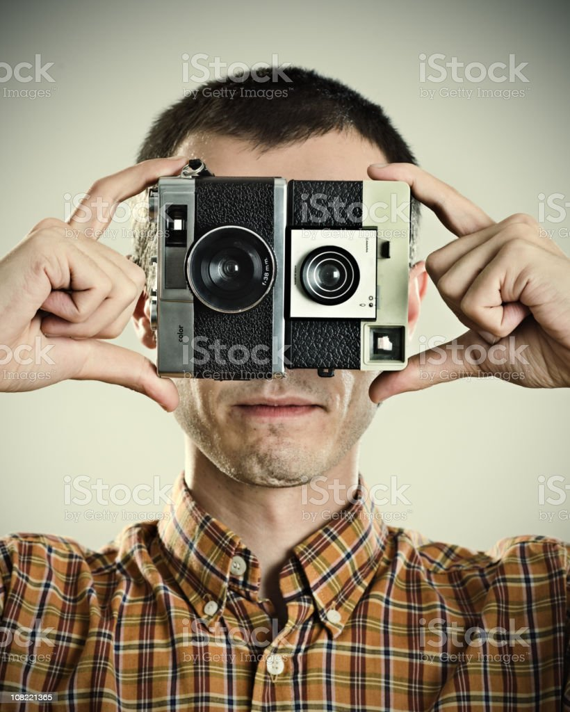Photographer Holding Cameras to Eyes royalty-free stock photo