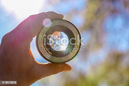 Photographer holding up lens