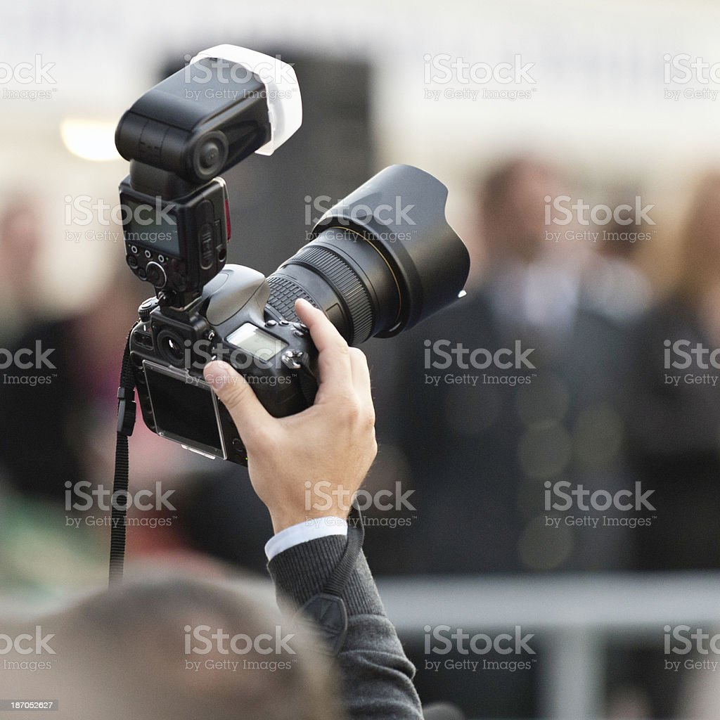 Photographer in the crowd stock photo
