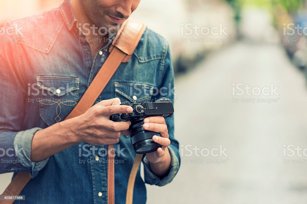 Photographer in the street. Lens flare stock photo
