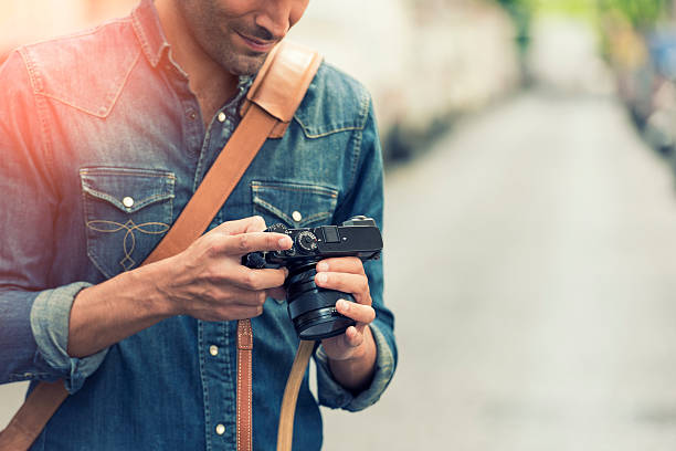 Photographer in the street. Lens flare – Foto