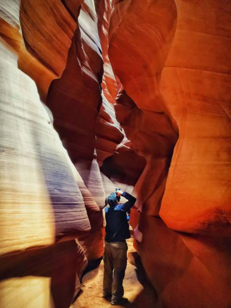 photographer in upper antelope canyon. Page, Arizona. USA stock photo