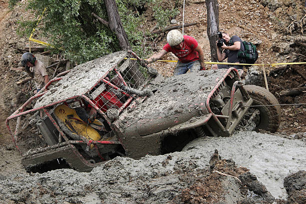 photographer is taking picture of 4wd off-road vehicle in mud - cable winch stock photos and pictures