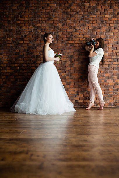 Photographer is taking pictures the bride in the studio picture id540387546?b=1&k=6&m=540387546&s=612x612&w=0&h=aulqmmipeneu5goukihbvkv6vddquzmmnz1wtjpmteu=