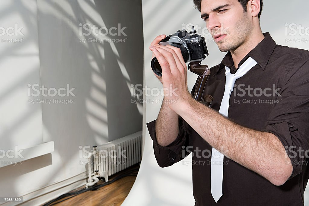 Photographer looking at a broken camera royalty-free stock photo