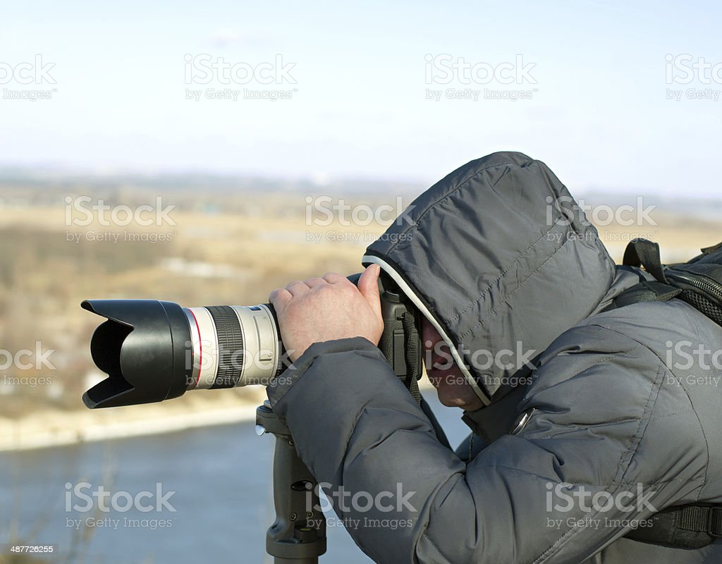 Photographer looking through the viewfinder stock photo