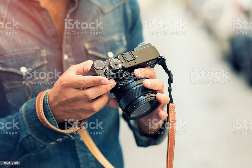 Photographer makes its settings. Background street. Lens flare stock photo