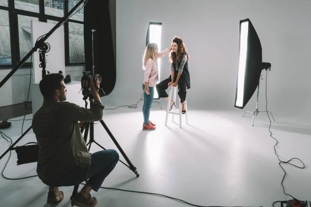 photographer, makeup artist and model stock photo